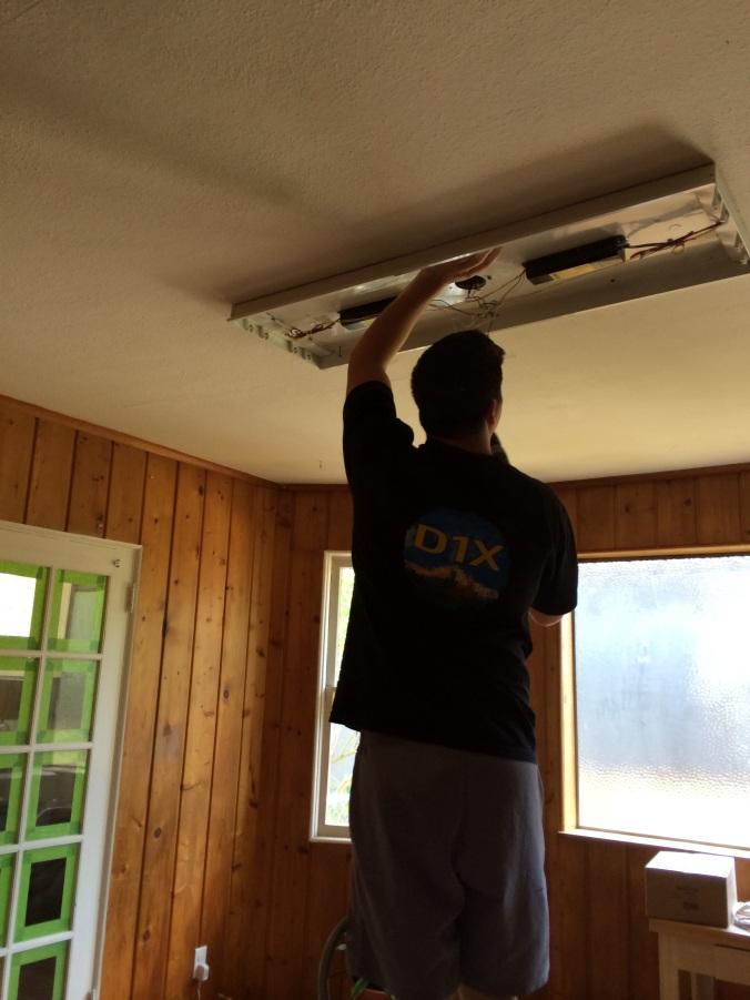 Dylan uninstalling a light fixture
